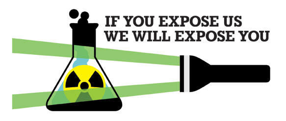 Image of torch shining light on chemical flask and radioactive warning sign